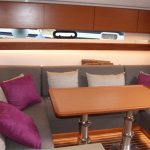 Relax in the saloon on the Bavaria 450 on your bareboat charter in Mallorca