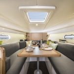 Spacious dining quarters onboard your next boat charter