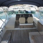 Relax on the spacious flybridge on the Fairline Squadron 55 yacht charter in Portals