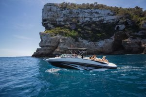 Cruise the beautiful waters of Ibiza on the Rinker 246 boat rental