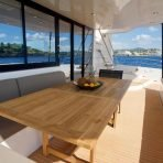 Dining area on board the electric catamaran for charter